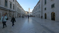 People walking and standing and a pigeon flying on Placa street, Dubrovnik - stock footage