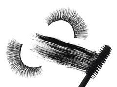 Stroke (sample) of black mascara and false eyelash isolated on white macro Stock Photos