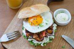Shot of burger with fried egg top view Stock Photos