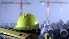 Stock Video Footage of contractor theme, blueprints, plans, hard hat, tools