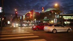 Traffic intersection La Brea Avenue and Santa Monica Blvd West Hollywood night Stock Footage