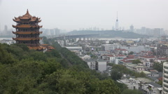 Yellow Crane Tower pagoda, Yangtze river bride, Wuhan city skyline, China Stock Footage