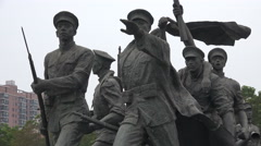 Statue of soldiers resembling the 1911 Wuchang uprising in China Stock Footage