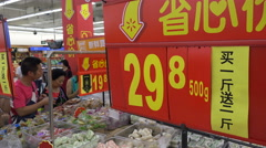 People do grocery shopping inside a Walmart supermarket in Wuhan, China - stock footage