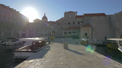 View of the City Walls and the Old Port from a stone dock in Dubrovnik Stock Footage