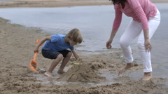 Grandmother and Grandchild at the beach Stock Footage