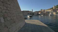 View of boats anchoring in the Old Port and  walls of Saint John Fort, Dubrovnik Stock Footage