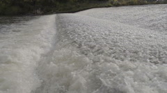 Salmon Jumping Over Weir In River Rapids - stock footage