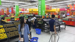 People shop for groceries in popular Western supermarket in China, Asia - stock footage