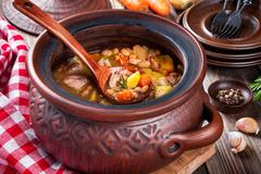 Vegetable stew with white beans, potatoes, carrots and chicken - stock photo
