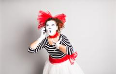 mime with smartphone. Concept of  April Fools Day - stock photo