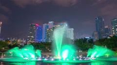 night kuala lumpur fountain show KLCC park panorama 4k time lapse malaisia - stock footage