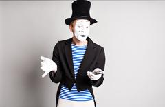 Mime with smartphone. Concept of  April Fools Day Stock Photos