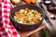 Vegetable stew with white beans, potatoes, carrots Stock Photos