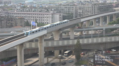 China modern infrastructure, metro rides above highways in Wuhan city Stock Footage