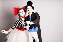 Funny couple of mimes taking a selfie photo,  April Fools Day - stock photo
