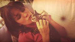 A beautiful girl plays with a kitten, Vintage look, 60's. Portrait. Stock Footage