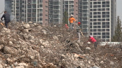 China poverty, construction workers search through rubble of old buildings Stock Footage
