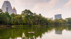 lumpini park day lake reflection bay panorama 4k time lapse bangkok thailand - stock footage