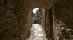 Narrow street with arch between stone buildings in Dubrovnik Stock Footage