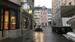 Street cleaner passing by in a European city Stock Footage