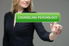Businesswoman presses button  counseling psychology on virtual screens - stock photo