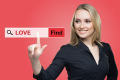 Find Love word on red  virtual screen touching by business woman - stock photo