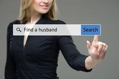 woman presses button in the browser -  find a husband. technology and internet - stock photo