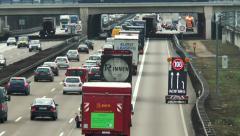 Warning sign on German highway, traffic jam Stock Footage