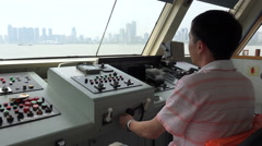 Chinese ferry captain crossing Yangtze river in Wuhan, pilothouse, cabin Stock Footage