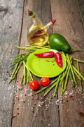 Still life with green plate asparagus, avocado Stock Photos