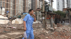 New apartment buildings arise behind taken down quarter in Wuhan, China - stock footage