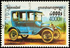 Old car Ford (1915) on postage stamp Stock Photos
