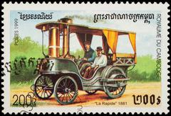 Old car La Rapide (1881) on postage stamp Stock Photos