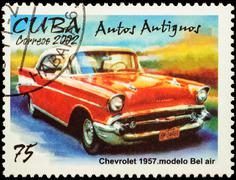 Old car Chevrolet Bel Air (1957) on postage stamp Stock Photos