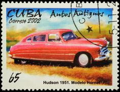 Old car Hudson Hornet (1951) on postage stamp Stock Photos