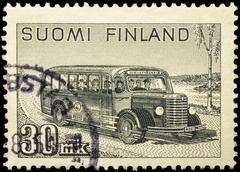 Old postal bus rides on rural road Stock Photos