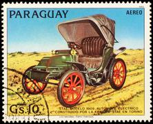 Old electric car STAE (1909) on postage stamp Stock Photos