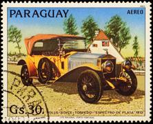 Old car Rolls-Royce Silver Ghost (1913) on postage stamp Stock Photos