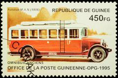 Old autobus MAN (1906) on postage stamp Stock Photos