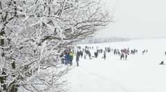 Masopust ethnics carnival, people playing in snow .Background Stock Footage