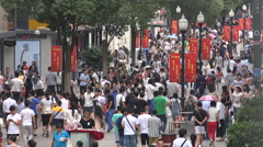 China domestic consumption, consumers, commercial shopping street in Wuhan - stock footage