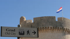 Street sign pointing to the Old Town and Minceta Tower, Dubrovnik Stock Footage