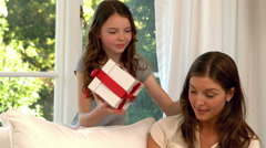 Daughter surprising her mother with gift Stock Footage