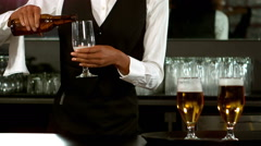 Pretty barmaid pouring beer in a glass Stock Footage