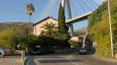 Cars driving under Franjo Tudjman Bridge in Dubrovnik Stock Footage
