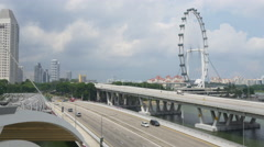 Sunny day famous flyer traffic street marina bay sands hotel panorama singapore Stock Footage