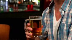 Handsome man having a pint Stock Footage