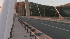 Amazing view of cars driving on Franjo Tudjman Bridge at sunset in Dubrovnik Stock Footage