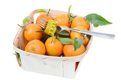Tangerins in the box Stock Photos
